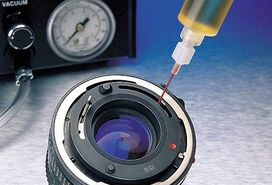 Lens is glued from dispenser to lens with glue from Panacol
